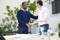 Business partners shaking hands in agreement