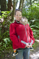 Woman hiking outdoors with young child