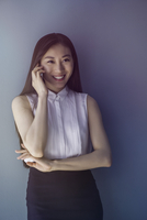Woman smiling while talking on cell phone