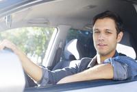 Man enjoying commute in comfortable car