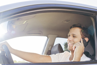 Man chatting on phone while driving