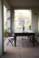 Table and chairs set on veranda