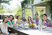 Friends having meal together, portrait