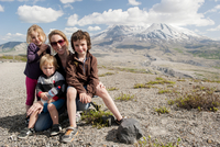 Mother and children posing in front of Mount St. Helens, Washington, USA
