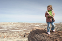 Girl visiting Petrified National Forest in Arizona, USA