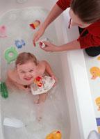 Boy sitting in bathtub