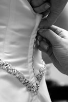 Person buttoning wedding dress