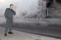man drinking coffee on foggy street