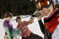 Man videotaping skiing friends