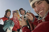 Friends smiling for camera on ski slope