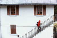 Skier walking up staircase of building