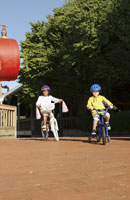 Children riding bicycles in park