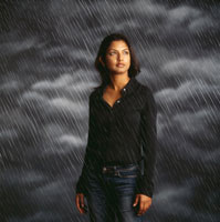 Woman standing in rainstorm