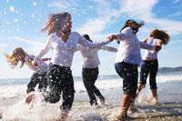 Girls holding hands and splashing water