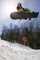 Snowboarder jumping in midair