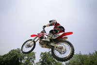 Motorcyclist jumping midair