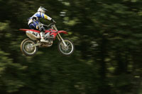 Blurred motorcyclist jumping in midair