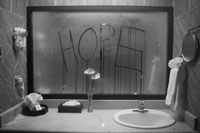 Hope written on steamy mirror