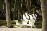 Empty loveseat on beach