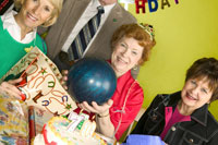 Woman holding ball as birthday present