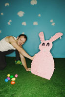 Man pushing over Easter bunny
