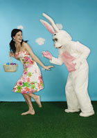 Woman running away from Easter bunny