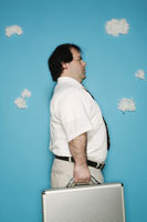 Man carrying metal briefcase