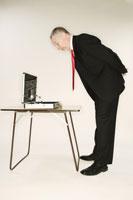 Businessman examining briefcase