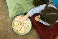 Young girl eating popcorn