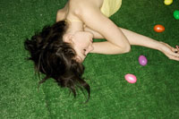 Woman sleeping with Easter eggs