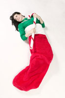 Woman inside in large Christmas stocking
