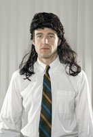 Businessman wearing mullet wig