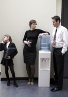 People talking by the water cooler