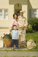 Hispanic military soldier and family