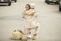 Military soldier hugging  daughter