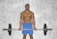 African male athlete lifting weights