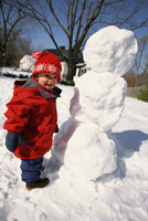 Toddler building snowman