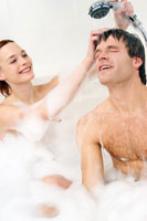 Couple taking bubble bath together