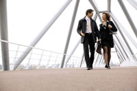 Businesspeople walking and talking