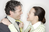 Woman pulling on husbands tie