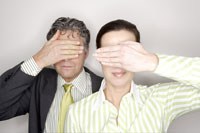 Businesspeople covering their eyes