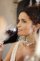 Woman drinking wine at dinner party