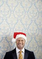 Smiling man in Santa hat