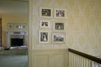 Framed photos mounted on wall