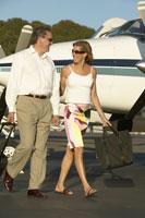 Couple boarding airplane