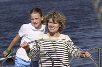 Woman steering boat