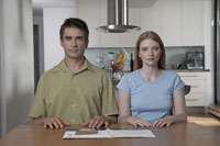 Man and woman sitting at kitchen table