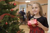 Young girl holding Christmas present