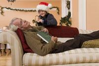 Grandson surprising sleeping grandfather