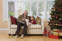 Man playing with granddaughter